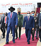 Egypt's President Abdel Fattah al-Sisi and South Sudan's President Salva Kiir, wearing protective face masks, stand as they listen to national anthems in Juba, South Sudan, November 28, 2020. Photo by Egyptian President Office