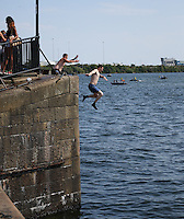 Saturday July 26th 2014 <br /> Pictured: Cardiff Bay <br /> RE: Man wearing socks jumps into the water at Cardiff Bay during the heat wave