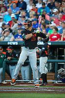 Willie Abreu (13) of the Miami Hurricanes bats during a game between the Miami Hurricanes and Florida Gators at TD Ameritrade Park on June 13, 2015 in Omaha, Nebraska. (Brace Hemmelgarn/Four Seam Images)