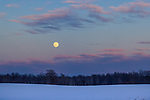 A full moon rising over a wintery landscape in northern Wisconsin.