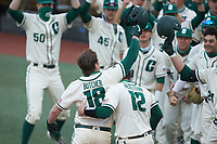 Will Butcher (18) of the Charlotte 49ers is greeted at home plate by teammate Aaron McKeithan (12) after hitting a home run against the Tennessee Volunteers at Hayes Stadium on March 9, 2021 in Charlotte, North Carolina. The 49ers defeated the Volunteers 9-0. (Brian Westerholt/Four Seam Images)