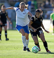 Stacy Bishop (left) and Adriane (21) battle for the ball. Boston Breakers defeated FC Gold Pride 1-0 at Buck Shaw Stadium in Santa Clara, California on July 19, 2009.
