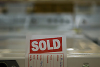 A Sold sign sits on appliances in a store
