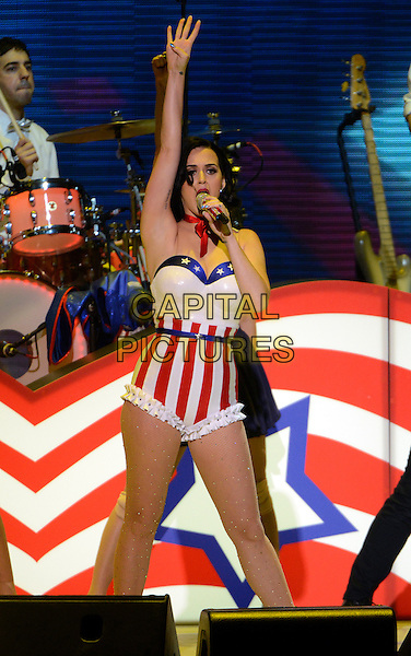 """19 January 2013 - Washington D.C, District of Columbia - Katy Perry. """"Kids' Inaugural: Our Children. Our Future at the Washington Convention Center. .on stage in concert live gig performance performing music full length red white blue stars stripes hat tights ribbon shorts corset singing hand arm in air 3/4.CAP/ADM/CNP/RS.©Ron Sachs/CNP/AdMedia/Capital Pictures."""