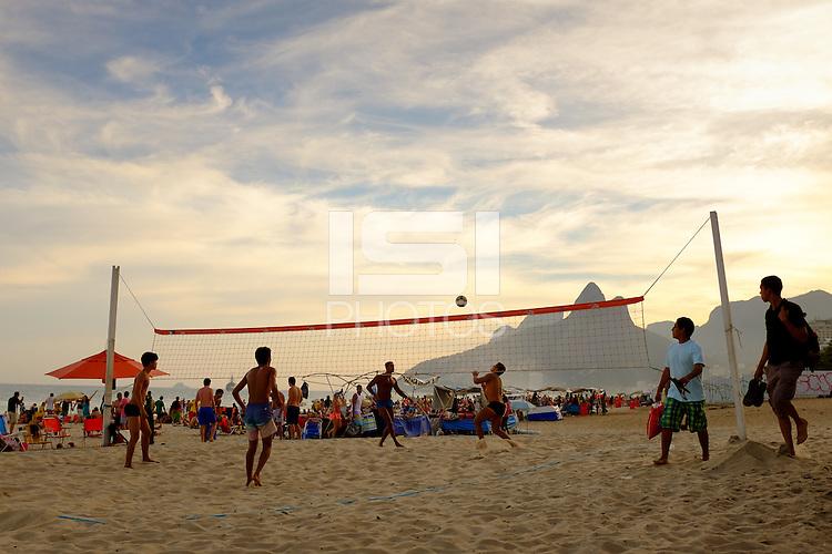 people play volley football over a net on Ipanema beach in Rio de Janiero