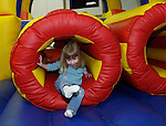 "TORRINGTON, CT 01/01/09- 010209BZ03- Abigail Foulds, 2, of Torrington, climbs out of an inflatable obstacle course during ""last night""activities at the Torrington Armory Friday night.   The event, a celebration usually held on New Year's Eve, was rescheduled due to inclement weather.<br /> Jamison C. Bazinet Republican-American"