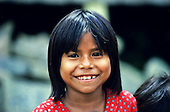 Manaus, Brazil. Smiling caboclo girl with a toothy grin.