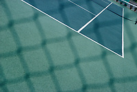 Tennis courts as seen through chain link fence