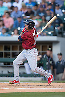 Jordan Danks (33) of the Lehigh Valley IronPigs follows through on his swing against the Charlotte Knights at BB&T BallPark on May 30, 2015 in Charlotte, North Carolina.  The IronPigs defeated the Knights 1-0.  (Brian Westerholt/Four Seam Images)