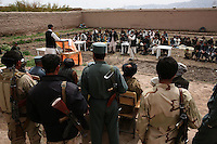 Guards watch the areas as warlord and 'zone comander' Matiuallah makes and appreance at a school opening he has funded. Matiullah control the road between Kandahar and Tarin Kot and no convoys can pass with out his permission abd or assistance.