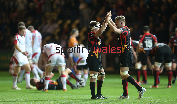 Dragons pair Phil Price and Lewis Evans celebrate victory over Ulster in their first match of the season.<br /> RaboDirect Pro 12<br /> Newport Gwent Dragons v Ulster<br /> Rodney Parade<br /> 06.09.13<br /> <br /> ©Steve Pope-SPORTINGWALES