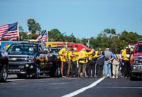 Aug 18, 2019; Brainerd, MN, USA; NHRA safety safari rescue crews pray together prior to the Lucas Oil Nationals at Brainerd International Raceway. Mandatory Credit: Mark J. Rebilas-USA TODAY Sports