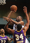 Zach Graham, of the Reno Bighorns, shoots over Los Angeles D-Fenders Malcolm Thomas, left, and Zach Andrews during the men's basketball game, in Reno, Nev., on Friday, Jan. 6, 2012. The De-Fenders won 109-78..Photo by Cathleen Allison