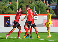 Lincoln City's Adam Jackson celebrates scoring his side's second goal with team-mates Tom Hopper, left, and Anthony Scully<br /> <br /> Photographer Chris Vaughan/CameraSport<br /> <br /> The EFL Sky Bet League One - Saturday 12th September 2020 - Lincoln City v Oxford United - LNER Stadium - Lincoln<br /> <br /> World Copyright © 2020 CameraSport. All rights reserved. 43 Linden Ave. Countesthorpe. Leicester. England. LE8 5PG - Tel: +44 (0) 116 277 4147 - admin@camerasport.com - www.camerasport.com - Lincoln City v Oxford United