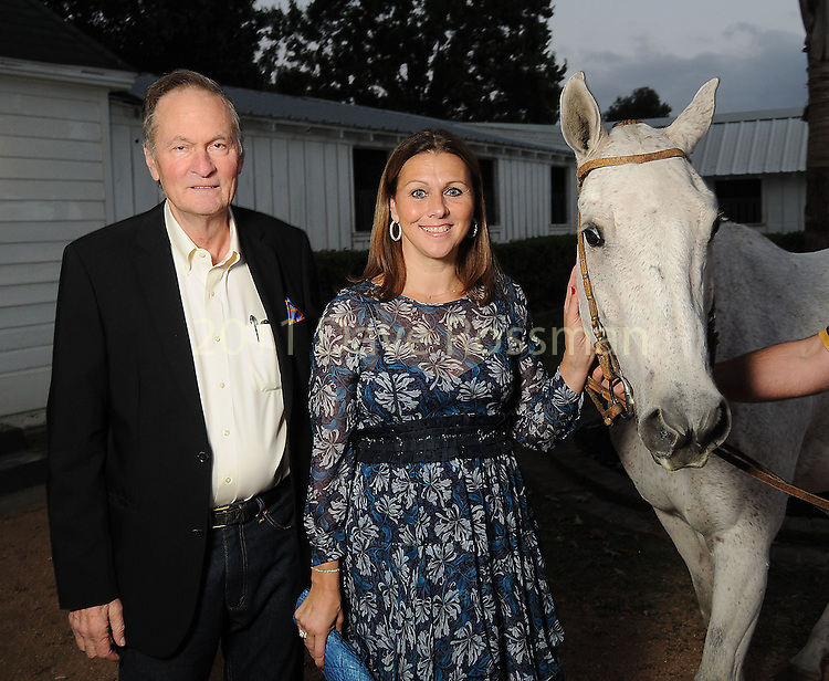 Fred and Donatella Benckenstein with Indio at the Nature Conservancy's Nature Rocks  Gala at the Houston Polo Club Thursday Oct. 22,2015.(Dave Rossman photo)