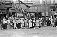 Waiting for a street car in Chicago, Illinois, 1940.<br /> <br /> Photo by John Vachon.