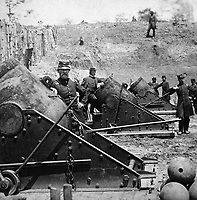 The Siege of Yorktown, Va.  Immense batteries of enormous guns and mortars were planted all along the line by the First Connecticut Heavy Artillery.  This is a battery of 13-inch sea-coast mortars.  April 1862. Stereo. (National Archives Gift Collection)<br /> Exact Date Shot Unknown<br /> NARA FILE#:  200-CC-375<br /> WAR & CONFLICT BOOK #:  165