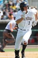 Charleston RiverDogs infielder John Murphy #3 at bat during a game against the Greenville Drive at Joseph P. Riley Jr. Ballpark  on April 9, 2014 in Charleston, South Carolina. Greenville defeated Charleston 6-3. (Robert Gurganus/Four Seam Images)