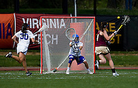 Kaitlin Gaiss (33) of Duke stands her ground as  Brittany Wilton (1) of Boston College moves in for a shot during the first round of the ACC Women's Lacrosse Championship in College Park, MD.  Duke defeated Boston College, 17-6.