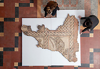 BNPS.co.uk (01202) 558833<br /> Pic: ZacharyCulpin/BNPS<br /> <br /> Museum staff prepare to hang the mosaic <br /> <br /> PICTURED: An important Roman mosaic that has been saved for the nation went on display today at a county museum.<br /> <br /> The Dorset Museum unveiled the 1,700-year-old panel depicting a leopard attacking an antelope that it acquired earlier this year to stop it from going abroad. <br /> <br /> It forms the centrepiece for the venue which is about to reopen following a £16m transformation that has taken three years.