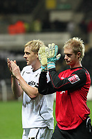 Pictured L-R: Garry Monk captain and Alan Tate of Swansea who substituted injured goalkeeper Dorus de Vries thanks his team's supporters after the final whistle. <br /> Re: Coca Cola Championship, Swansea City Football Club v Queens Park Rangers at the Liberty Stadium, Swansea, south Wales 21st October 2008.