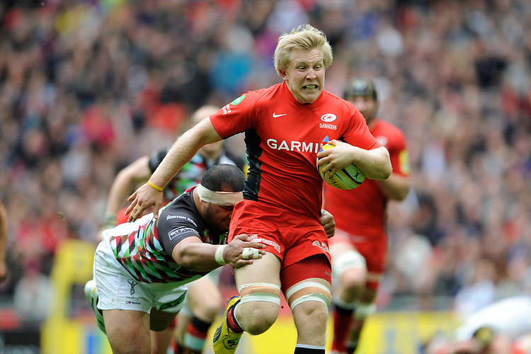 Jackson Wray of Saracens is chased down by Maurie Fa'asavalu of Harlequins during the Aviva Premiership match between Saracens and Harlequins at Wembley Stadium on Saturday 31st March 2012 (Photo by Rob Munro)