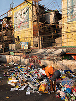 Street Photography, Manila, Philippines Sorting through the leftovers at a Garbage dump site in the slum area of Tondo, North Harbour