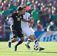 PASADENA, CA – June 25, 2011: USA player Carlos Bocanegra (3) and Mexico player Giovani Dos Santos (10) during the Gold Cup Final match between USA and Mexico at the Rose Bowl in Pasadena, California. Final score USA 2 and Mexico 4.