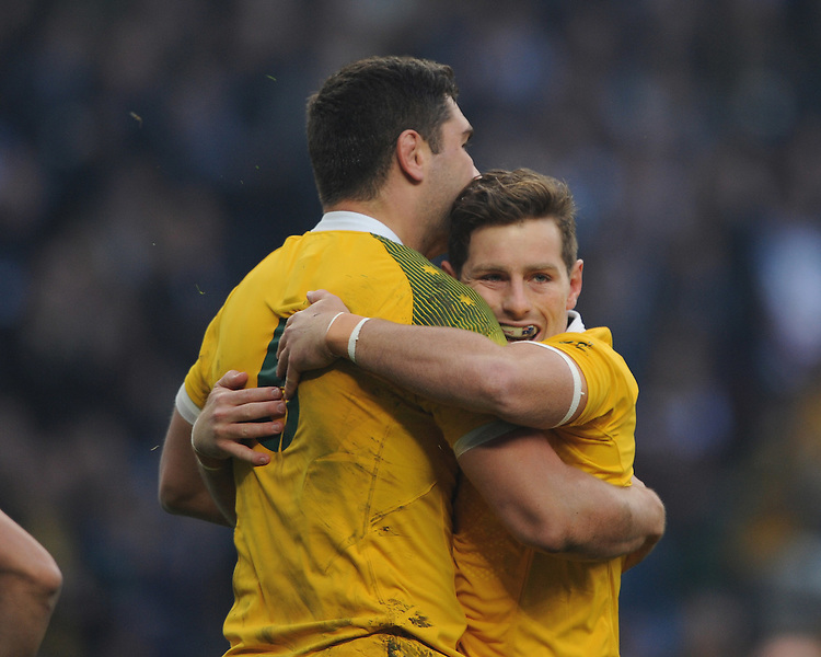Rob Simmons of Australia (left) is congratulated by teammate Bernard Foley of Australia after scoring an early try during the Semi Final of the Rugby World Cup 2015 between Argentina and Australia - 25/10/2015 - Twickenham Stadium, London<br /> Mandatory Credit: Rob Munro/Stewart Communications