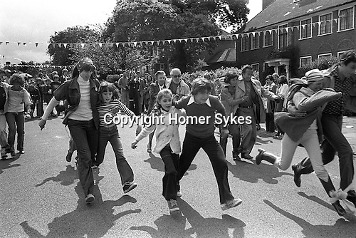 Silver Jubilee Street Party 1977 Hampstead Garden suburb. Children parents and adults take part in a three-legged race.<br /> <br /> My ref 8/2065/,1977,