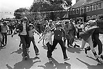 Silver Jubilee Street Party 1977 Hampstead Garden suburb. Children parents and adults take part in a three-legged race.<br />