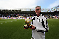 Pictured: Groundsman Dan Duffy with his Premier League Award for the Liberty Stadium pitch. Sunday 04 May 2013<br /> Re: Barclay's Premier League, Swansea City FC v Fulham at the Liberty Stadium, south Wales.