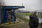 Glossop North End 0 Barnoldswick Town 1, 19/02/2011. Surrey Street, North West Counties League Premier Division. Glossop North End supporters standing in an enclosure known as The Trenches at the club's Surrey Street ground watching as their team concede the only goal of the game against Barnoldswick Town (in yellow) in the Vodkat North West Counties League premier division. The visitors won the match by one goal to nil watched by a crowd of 203 spectators. Glossop North End celebrated their 125th anniversary in 2011 and were once members of the Football League in England, spending one season in the top division in 1899-00. Photo by Colin McPherson.
