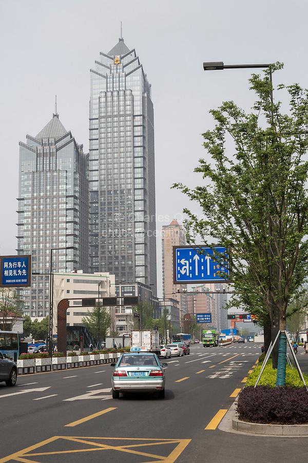 Suzhou, Jiangsu, China.  Office Buildings and Morning Traffic.