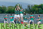 High fielding action as Oisin Maunsell and Tadgh Reen of  St Brendans jump with Kieran Johnston of Mid Kerry for possession in the Minor Football Championship quarter final.