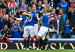 Rangers v St Johnstone....28.08.10  .Sasa Papac celebrates his goal with Vladimir Weiss and Kenny Miller.Picture by Graeme Hart..Copyright Perthshire Picture Agency.Tel: 01738 623350  Mobile: 07990 594431