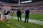 Houston, Texas<br /> October 2, 2011<br /> <br /> Team owner Bob McNair (blue jacket) with son Cary McNair (black jacket) watch as the players warm up and the game is about to begin. <br /> <br /> The Houston Texans defeated the Pittsburgh Steelers at the Reliant Stadium 17 to 10.