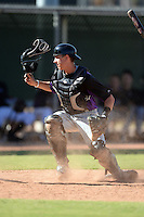 Colorado Rockies catcher Robbie Perkins (25) during an instructional league game against the Los Angels Angels of Anaheim on September 30, 2013 at Tempe Diablo Stadium Complex in Tempe, Arizona.  (Mike Janes/Four Seam Images)