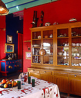 A magical atmosphere has been created in this kitchen in which furniture and walls have been painted in bright primary colours