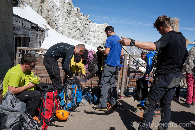 Mountain Climbers packing up their equipment after coming off of Mont-Blanc at Aguille du Midi, Chamonix-Mont-Blanc, France