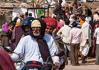 Abnaheri, Rajasthan, India.  Village Men Riding on a Motorbike--one Helmet, two Turbans.