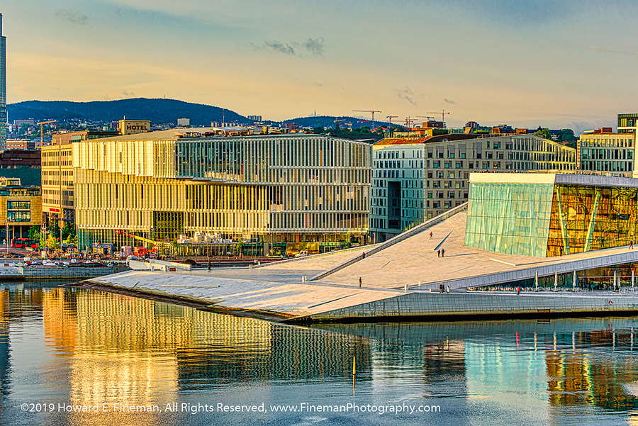 Oslo Opera House bathed in golden hour warm glow