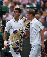 25-06-13, England, London,  AELTC, Wimbledon, Tennis, Wimbledon 2013, Day two, Novak Djokovic (SRB) passing Florian Mayer (GER)<br /> <br /> <br /> <br /> Photo: Henk Koster
