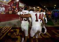 LOS ANGELES, CA - SEPTEMBER 11: Ricky Miezan #45 and Jacob Mangum-Farrar #14 of the Stanford Cardinal walk towards the tunnel after a game between University of Southern California and Stanford Football at Los Angeles Memorial Coliseum on September 11, 2021 in Los Angeles, California.