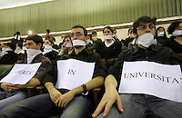 "Studenti imbavagliati nell'aula magna dell'Universita' La Sapienza di Roma, 17 gennaio 2008, durante l'inaugurazione dell'anno accademico, in segno di protesta dopo l'annullamento della presenza di Papa Benedetto XVI..Students demonstrate gagged, holding signs reading ""Freedom at University"" at Rome's La Sapienza University, 18 january 2008, during the inauguration of the academic year, as a sign of protest after that Pope Benedict XVI canceled his visit.. UPDATE IMAGES PRESS/Riccardo De Luca"
