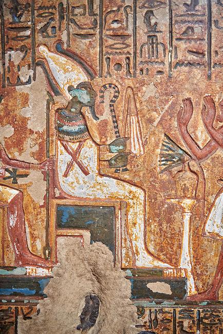 "Ancient Egyptian stele of scraftsman Minhotep in adoration of Osiris, limestone, New Kingdom, 18th Dynasty, (1336-1292 BC), Deir el-Medina, Drovetti cat 1619. Egyptian Museum, Turin. <br /> <br /> The stele is dedicated to Osiris, Anubis and Hathor ""Mistress of the World""."