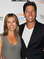 HOLLYWOOD, LOS ANGELES, CA, USA - SEPTEMBER 18: Sandra Hess, Michael Trucco arrive at the 'Get Lucky For Lupus' 6th Annual Poker Tournament held at Avalon on September 18, 2014 in Hollywood, Los Angeles, California, United States. (Photo by Celebrity Monitor)
