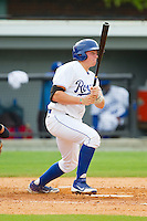 Chad Johnson (15) of the Burlington Royals follows through on his swing against the Greeneville Astros at Burlington Athletic Park on July 1, 2013 in Burlington, North Carolina.  The Astros defeated the Royals 7-0 in Game One of a doubleheader.  (Brian Westerholt/Four Seam Images)