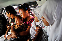 Muslims and Christians share a minibus ride near Passo, the town at bottleneck isthmus between mainly Christian and mainly Muslim parts of Ambon. The 1999-2002 religious war between Maluku's Christian and Muslim populations, mainly centred on Ambon Island, led to over 5000 deaths and to around 500,000 people become displaced. Destroyed homes and offices, churches and mosques are slowly being either torn-down or renovated.  Urban centres, such as Ambon City, continue to be split along largely sectarian lines, and tensions are never far below the surface. Riots between Christian and Muslim youths erupted in September 2011 and, most recently, June 2012, though luckily simmered down just as quickly, partly due to community leaders learning how to defuse tensions from the earlier, more devastating, conflagration. /Felix Features