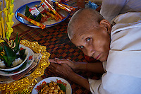 A buddhist Nun at Wat Phnom Krom Pagoda and Monastery near the Tonle Sap, Cambodia